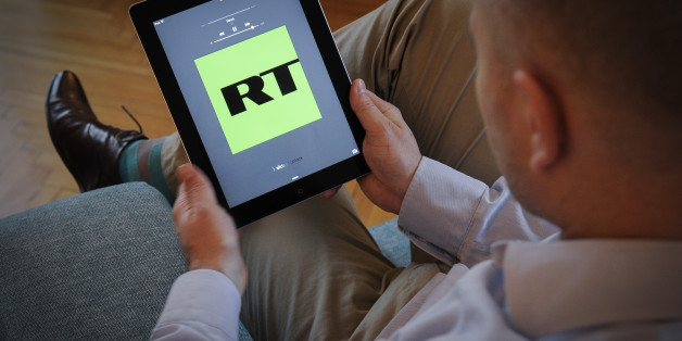 The Russia Today application is seen on an iPad on November 10, 2017. The Russian news outlet has said it will cooperate with the demands of the  Department of Justice and register their Amreican subsidiary as a foreign agent after intelligence agencies concluded it was responsible for facilitating fake-news to influence election campaigns. (Photo by Jaap Arriens/NurPhoto via Getty Images)
