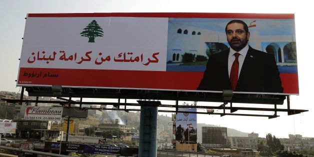 A poster of Lebanese Prime Minister Saad Hariri is seen on a giant billboard that reads in Arabic 'Your dignity is Lebanon's dignity' on the highway of Zouk Mosbeh, north of Beirut, on November 14, 2017. / AFP PHOTO / JOSEPH EID        (Photo credit should read JOSEPH EID/AFP/Getty Images)