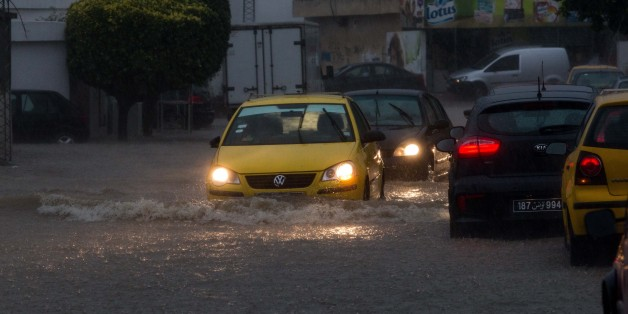 TUNIS, TUNISIA - JUNE 06: Vehicles pass trough the puddles in a street as it rains in Tunis, Tunisia on June 06, 2017. (Photo by Amine Landoulsi/Anadolu Agency/Getty Images)