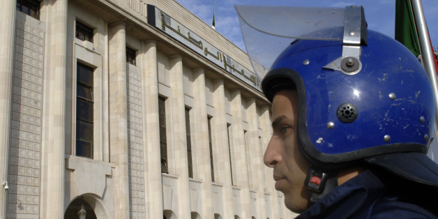 An Algerian policeman stands guard outside the People's National Assembly bulding in the capital Algiers on November 27, 2016. / AFP / RYAD KRAMDI        (Photo credit should read RYAD KRAMDI/AFP/Getty Images)