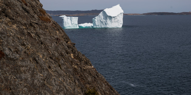 PORT KIRWAN, NEWFOUNDLAND - APRIL 26: An iceberg floats in the Atlantic Ocean, April 26, 2017 off the coast of Port Kirwan, Newfoundland, Canada. Icebergs break off from Baffin Island and Greenland every spring and drift down the stretch of water along the coast of Newfoundland and Labrador known as Iceberg Alley. According to media reports, the higher number of icebergs this season can be attributed to uncommonly strong counter-clockwise winds that draw the icebergs south and possibly global warming, which could be making Greenland's ice sheet melt faster. (Photo by Drew Angerer/Getty Images)
