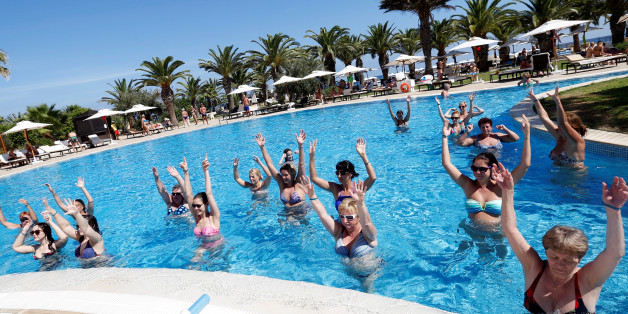Russian tourists take part in an aqua aerobics session in a swimming pool at the Steigenberger Kantaoui Bay resort, previously Imperial Marhaba hotel, in Sousse, Tunisia, September 29, 2017. Picture taken September 29, 2017. REUTERS/Zoubeir Souissi