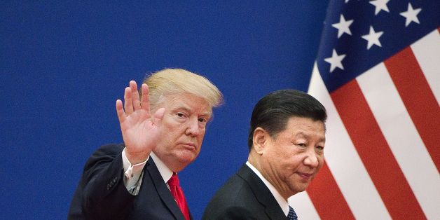 US President Donald Trump (L) and China's President Xi Jinping leave a business leaders event at the Great Hall of the People in Beijing on November 9, 2017.Donald Trump urged Chinese leader Xi Jinping to work 'hard' and act fast to help resolve the North Korean nuclear crisis, during their meeting in Beijing on November 9, warning that 'time is quickly running out'. / AFP PHOTO / Nicolas ASFOURI        (Photo credit should read NICOLAS ASFOURI/AFP/Getty Images)