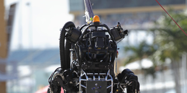 Boston Dynamics' Atlas, a high-mobility, humanoid robot designed to negotiate rough terrain, takes on an irregular surface in this terrain negotiation exercise in Homestead, Florida December 20, 2013.The south Florida city is hosting an international Robotics Challenge Trials this weekend, organized by the U.S. Defense Advanced Research Projects Agency (DARPA). The competition, for the creation of robots that can respond to natural and man-made disasters, was created following the 2011 Fukushima