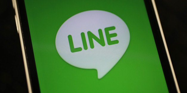 The logo of free messaging app Line is pictured on a smartphone in this photo illustration taken in Tokyo September 23, 2014. Naver Corp held off on an IPO for its Line Corp unit on the belief that the messaging app operator can command a better valuation by further building its revenue and profit, Naver's chief financial officer told Reuters on Tuesday. South Korea-based Naver said on Monday that it does not plan an initial public offering for Line this year, dashing market expectations for a d