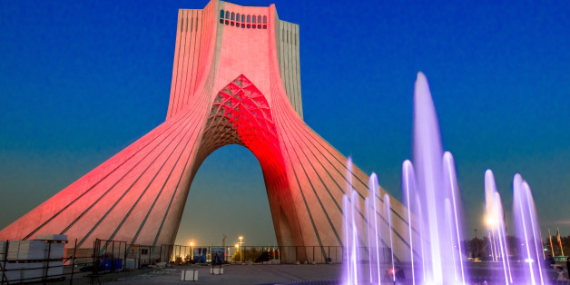 Beautiful night view of the Azadi tower with colorful fountain . The tower is one of the symbols of Tehran city. One of top 10 tourist attraction in Tehran, Iran.