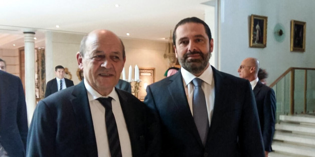 A picture taken with a cell-phone on November 16, 2017, shows French Foreign Minister Jean-Yves Le Drian posing for a photo with Lebanese Prime Minister Saad Hariri in the Saudi capital Riyadh.Hariri met with Le Drian in Riyadh on November 16, the most senior Western official he has met publicly since his shock resignation announcement earlier this month.The meeting came after the French foreign minister said that Hariri had accepted an invitation to visit France for talks with President Emmanue