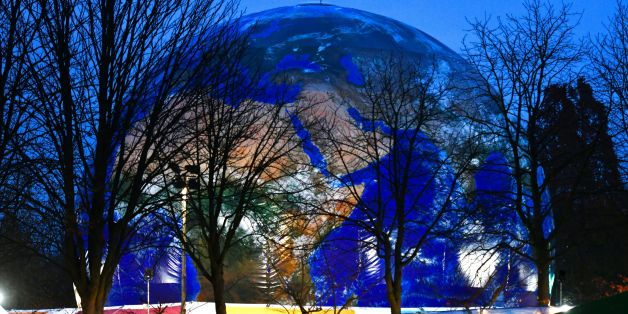 A mockup of a planet earth is displayed at the Rheinaue park during the COP23 United Nations Climate Change Conference in Bonn, Germany. / AFP PHOTO / PATRIK STOLLARZ        (Photo credit should read PATRIK STOLLARZ/AFP/Getty Images)