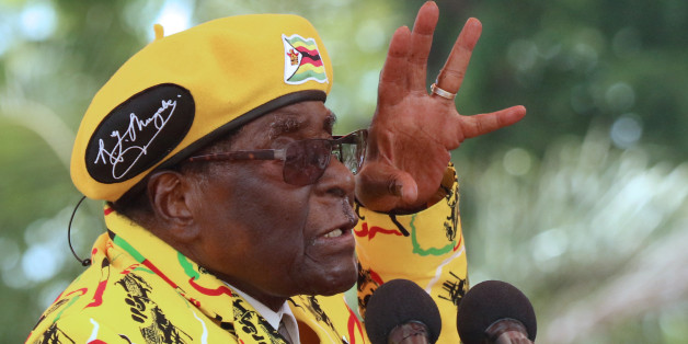 President Robert Mugabe gestures as he addresses a rally in Harare, Zimbabwe, November 8, 2017. REUTERS/Philimon Bulawayo