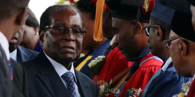 Zimbabwe President Robert Mugabe attends a university graduation ceremony in Harare, Zimbabwe, November 17, 2017. REUTERS/Philimon Bulawayo