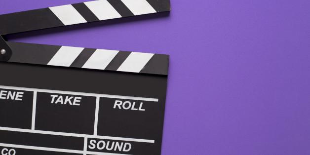 movie clapper on violet background