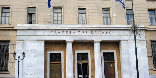 Athens, Greece - November 4, 2011: Entrance and part of the BANK OF GREECE building in Athens. It is the central bank of the country. Was established in 1927