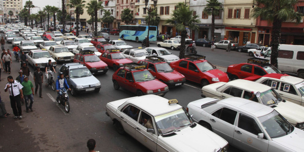 Taxi drivers protesting against a fuel hike bring traffic to a standstill outside the police headquarters in Casablanca's city centre June 11, 2012. Taxi drivers protested on Monday against a hike in fuel prices implemented by Moroccan Prime Minister Abdelilah Benkirane's government. REUTERS/Macao (MOROCCO - Tags: TRANSPORT BUSINESS POLITICS ENERGY)
