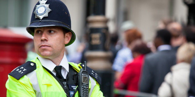 London, UK - April 29, 2011: London Metropolitan Police Officer in Central London keeping the streets safe during the celebration of the Royal Wedding between Prince William, Duke of Cambridge and Catherine Middleton, Duchess of Cambridge.