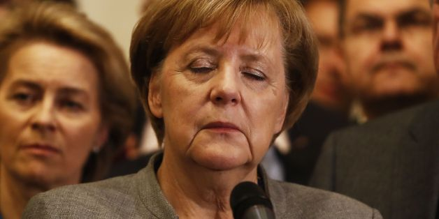 German Chancellor and leader of the Christian Democratic Union (CDU) party, Angela Merkel (C), closes her eyes after exploratory talks on forming a new government broke down on November 19, 2017 in Berlin.Tough talks to form Germany's next government stretched into overtime, putting Chancellor Angela Merkel's political future in the balance since failure to produce a deal could force snap elections. / AFP PHOTO / Odd ANDERSEN        (Photo credit should read ODD ANDERSEN/AFP/Getty Images)