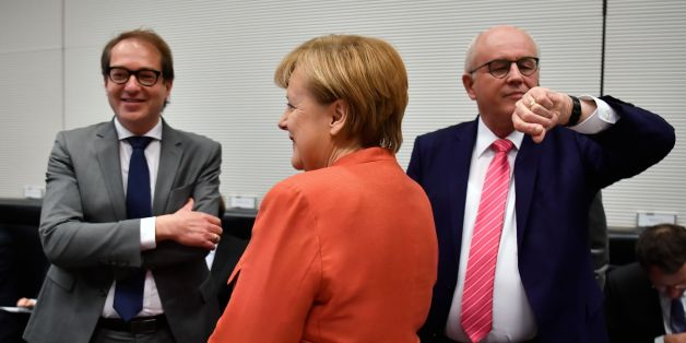German Chancellor Angela Merkel stands inbetween German Transport Minister Alexander Dobrindt (L) and Parliamentary group leader of the conservative CDU/CSU faction, Volker Kauder (R) prior to a parliamentary group meeting of the conservative CDU/CSU faction on November 20, 2017 in Berlin. 