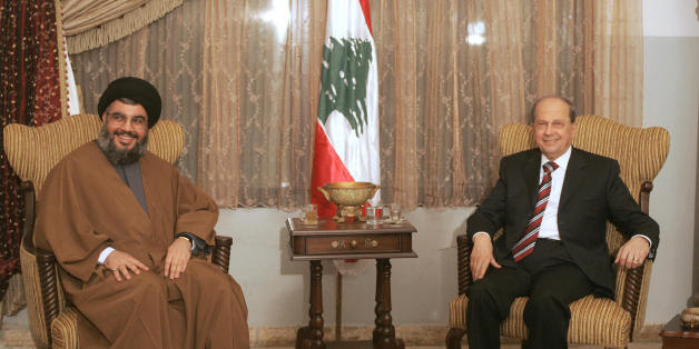 Beirut, LEBANON:  Hezbollah secretary general Hassan Nassrallah (L) and anti-Syrian legislator General Michel Aoun meet for the first time at a church in the southern suburb of Beirut 06 February 2006. Lebanon pointed the finger at Syria after the Danish consulate was torched during violent protests over controversial Prophet Mohammed cartoons that left one rioter dead and led to the interior minister's resignation. AFP PHOTO/JOSEPH BARRAK  (Photo credit should read JOSEPH BARRAK/AFP/Getty Image