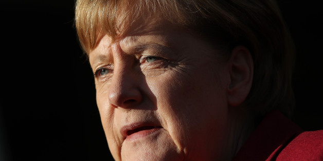 BERLIN, GERMANY - NOVEMBER 17:  A German Chancellor and leader of the German Christian Democrats (CDU) Angela Merkel speaks to the media as she arrives for further talks the morning after leaders of the four negotiating parties failed to reach consensus over issues in their preliminary coaliton talks on November 17, 2017 in Berlin, Germany. The German Christian Democrats (CDU), its sister party the Bavarian Christian Democrats (CSU), the Free Democratic Party (FDP) and the Greens Party (Buendnis