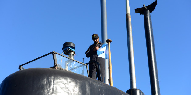 A crew member of the Argentine military submarine ARA San Juan stands on the vessel at the port of Buenos Aires, Argentina June 2, 2014. Picture taken on June 2, 2014. Armada Argentina/Handout via REUTERS ATTENTION EDITORS - THIS IMAGE WAS PROVIDED BY A THIRD PARTY.