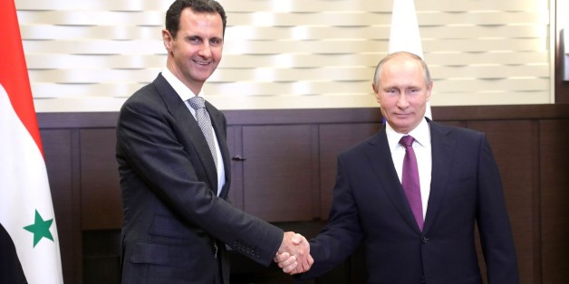 SOCHI, RUSSIA - NOVEMBER 21: (----EDITORIAL USE ONLY  MANDATORY CREDIT - ' KREMLIN PRESS OFFICE / HANDOUT' - NO MARKETING NO ADVERTISING CAMPAIGNS - DISTRIBUTED AS A SERVICE TO CLIENTS----) Russian President Vladimir Putin (R) shakes hands with Syrian President Bashar al-Assad (R) during their meeting in Sochi, Russia on November 21, 2017. (Photo by Kremlin Press Office / Handout/Anadolu Agency/Getty Images)