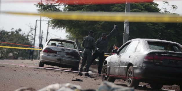 Police bomb squad personnel gather debris for analysis at the scene of a bomb blast in Nyanya, on the outskirts of Abuja, Nigeria, October 3, 2015. Two bombs went off on the outskirts of the Nigerian capital Abuja late on Friday, an official said, the first such incident in over a year. There was an unknown number of casualties, a spokesman for the National Emergency Management Agency said. He had no more details on the blasts in Kuje and Nyanya. Spokesman Manzo Ezekiel said that the bomb in Kuj