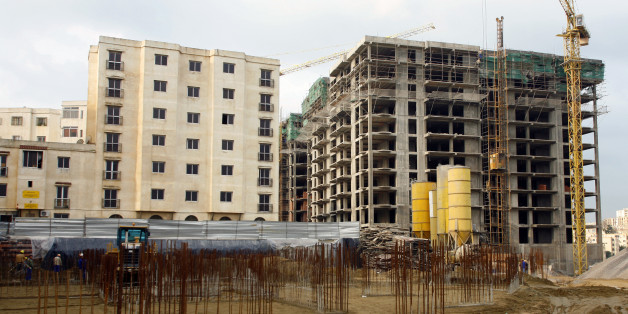 ALGIERS, ALGERIA - DECEMBER 6:  Life in the Algerian capital, a construction site for housing in the Kouba district on December 6, 2007 in Algiers, Algeria.  (Photo by Pascal Parrot/Getty Images)