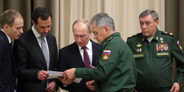 SOCHI, RUSSIA - NOVEMBER 21, 2017: Syria's President Bashar al-Assad (2nd L), Russia's President Vladimir Putin (C back), Russia's Defence Minister Sergei Shoigu (C front), and his first deputy, Chief of the General Staff of the Russian Armed Forces Valery Gerasimov (R) during a meeting at Bocharov Ruchei residence. Mikhail Klimentyev/Russian Presidential Press and Information Office/TASS (Photo by Mikhail Klimentyev\TASS via Getty Images)