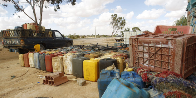 A view shows containers filled with fuel at the southern Libya-Tunisia border crossing in Dehiba, April 17, 2012. In the absence of proper border controls after uprisings which ousted autocratic leaders in both Tunisia and Libya, smugglers plying unmarked desert routes on the Tunisian-Libyan border are becoming ever bolder, and disputes over smuggling routes are becoming ever more violent. Picture taken April 17, 2012. To match Feature TUNISIA-SMUGGLING/   REUTERS/Zoubeir Souissi   (TUNISIA - Ta