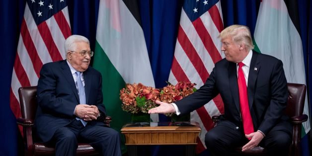 US President Donald Trump reaches to shake Palestinian Authority President Mahmoud Abbas's hand before a  meeting at the Palace Hotel during the 72nd United Nations General Assembly on September 20, 2017, in New York. / AFP PHOTO / Brendan Smialowski        (Photo credit should read BRENDAN SMIALOWSKI/AFP/Getty Images)