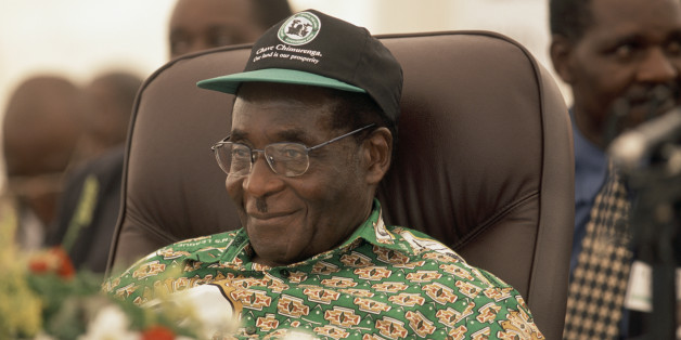 Zimbabwe President Robert Mugabe smiles as his policies are applauded at the sixth annual Zanu PF National Peoples Conference.
