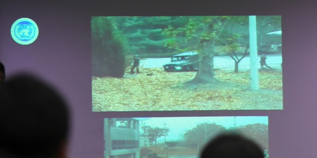A surveillance TV footage containing the moment of defection of a North Korean Soldier, is seen during a press briefing by the United Nations Command at the Defence Ministry in Seoul on November 22, 2017. A North Korean soldier crossed the border into the South in breach of a 1953 armistice agreement as he pursued a defector who was shot last week, the US-led United Nations Command (UNC) said on November 22. / AFP PHOTO / JUNG Yeon-Je        (Photo credit should read JUNG YEON-JE/AFP/Getty Images)