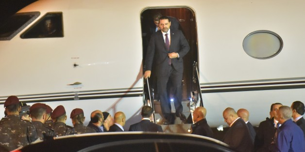 Lebanese Prime Minister Saad Hariri (C) arrives at Beirut International Airport on November 21, 2017.Lebanon's prime minister Saad Hariri returned to his home country late Tuesday, on the eve of its independence day and after a nearly three-week absence dominated by his surprise resignation. / AFP PHOTO / Fadel ITANI        (Photo credit should read FADEL ITANI/AFP/Getty Images)