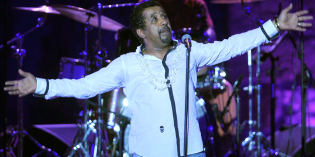 Algerian singer Cheb Khaled performs during the 49th session of International Festival of Carthage on July 21, 2013 at the Roman theatre of Carthage . AFP PHOTO / FETHI BELAID        (Photo credit should read FETHI BELAID/AFP/Getty Images)