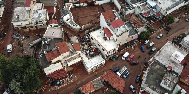 A drone picture taken on November 16, 2017 shows damage and mud covered streets in the town of Mandra, after a flash flood caused damages and killed 16 people. / AFP PHOTO / LEFTERIS PARTSALIS        (Photo credit should read LEFTERIS PARTSALIS/AFP/Getty Images)