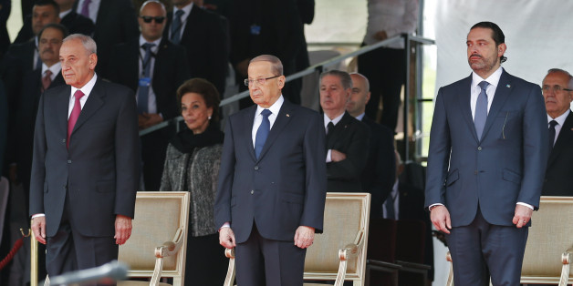 Lebanese prime minister Saad Hariri (R), President Michel Aoun (C) and House Speaker Nabih Berri attend a military parade to celebrate the 74th anniversary of Lebanon's independence in downtown Beirut, on November 22, 2017.Lebanon's prime minister Saad Hariri returned to his home country late, on the eve of its independence day and after a nearly three-week absence dominated by his surprise resignation. / AFP PHOTO / ANWAR AMRO        (Photo credit should read ANWAR AMRO/AFP/Getty Images)