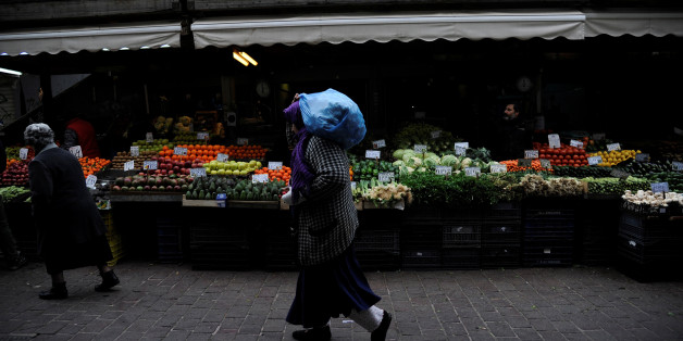 A woman walks past a vegetable market in central Athens, Greece February 11, 2017. REUTERS/Michalis Karagiannis