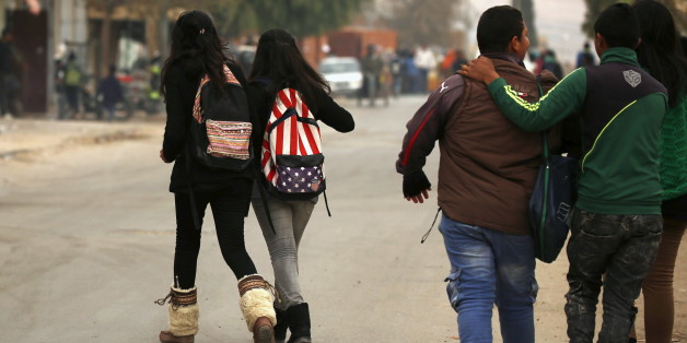 Students walks to their houses at the impoverished Zhor neighborhood of Kasserine, where young people have been demonstrating for jobs since last week, January 28, 2016. REUTERS/Zohra Bensemra