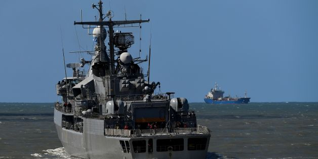 Argentina's Navy destroyer ARA Sarandi sails off to take part in the search of missing submarine ARA San Juan, from the north breakwater of Argentina's Navy base in Mar del Plata, on the Atlantic coast south of Buenos Aires, on November 21, 2017. An international search mission for a missing Argentine submarine entered its sixth day Tuesday as uncertainty over the fate of its 44 crew members gave way to rising anguish for families troubled by earlier false hopes. / AFP PHOTO / EITAN ABRAMOVICH        (Photo credit should read EITAN ABRAMOVICH/AFP/Getty Images)