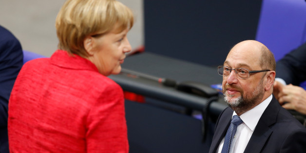 German Chancellor Angela Merkel speaks with Social Democratic Party (SPD) leader Martin Schulz as they attend a meeting of the Bundestag in Berlin, Germany, November 21, 2017. REUTERS/Axel Schmidt