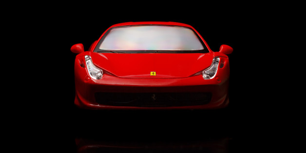 Krivoy Rog, Ukraine - August 22, 2014: Toy ferrari 458 Italia on black backgrond. The photo is made in a studio. Editorial Use Only.