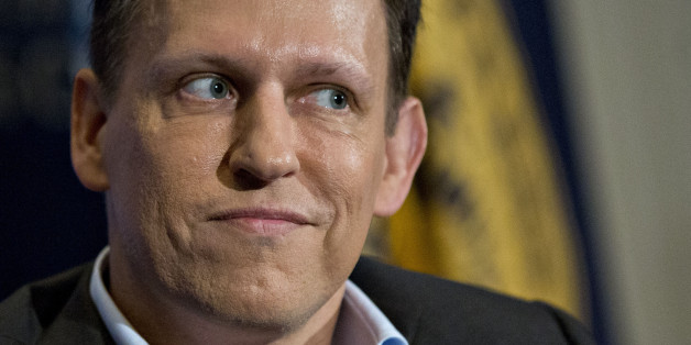 Peter Thiel, co-founder of PayPal Inc., pauses while listening to a question during a news conference at the National Press Club in Washington, D.C., U.S., on Monday, Oct. 31, 2016. Thiel, the Silicon Valley entrepreneur and Donald Trump supporter, endorsed him at the Republican National Convention and is planning to donate $1.25 million to Trump's campaign. Photographer: Andrew Harrer/Bloomberg via Getty Images
