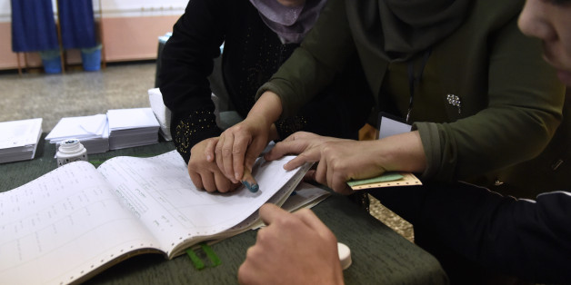Algerians cast their vote at a polling station in Algiers on November 23, 2017 as Algeria goes to the polls for local elections.  / AFP PHOTO / RYAD KRAMDI        (Photo credit should read RYAD KRAMDI/AFP/Getty Images)
