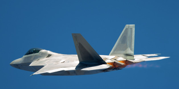 F-22 Raptor in a very unusual close view, with afterburners on