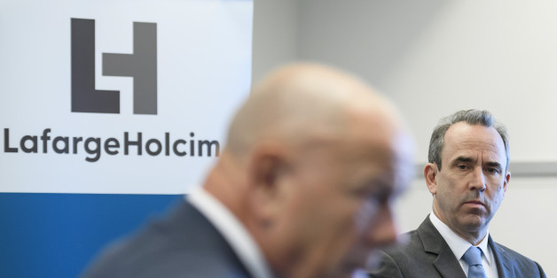 Outgoing CEO of the French-Swiss construction materials giant LafargeHolcim, Eric Olsen (R) listens to the company's  Chairman of the Board of Directors, Beat Hess during a press conference following the company's annual meeting in Zurich on May 3, 2017.Eric Olsen is stepping down following an internal investigation into the company's activities in Syria. LafargeHolcim posted a net profit of 226 million Swiss francs (208 million euros) in the first quarter, compared to a loss of 107 million a ye