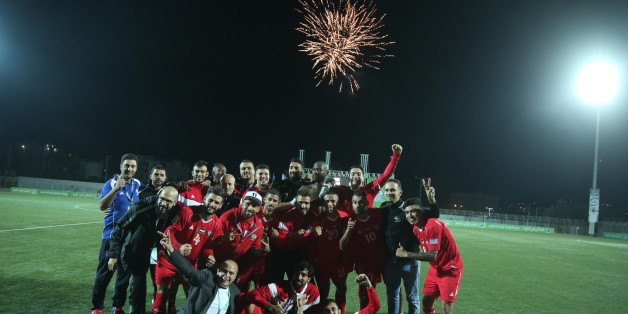 HEBRON, WEST BANK - OCTOBER 10 : Players of Palestine pose for a photo after winning the 2019 AFC Asian Cup Qualifying Group D soccer match between Palestine and Bhutan with the score standing '10 to 0' at Dora International Stadium in Hebron, West Bank on October 10, 2017. (Photo by Issam Rimawi/Anadolu Agency/Getty Images)