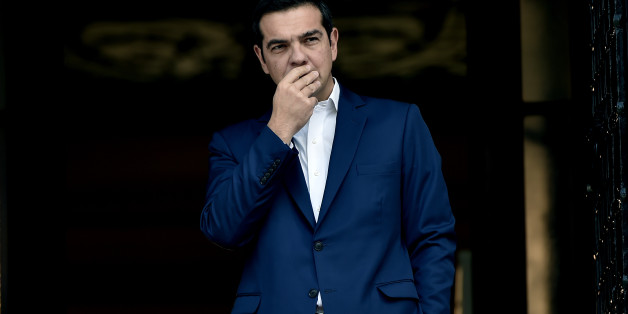 Greek Prime Minister Alexis Tsipras reacts as he  waits for the his South Korean counterpart at his office in Athens on October 23, 2017. Greece has slightly revised downwards, to 3.7% from the previously estimated 3.9%, its primary budget surplus in 2016, a result that remains the requirements of its creditors, the EU and the IMF. This announcement, by the Greek statistical agency Elstat, coincides with the return to Athens of its bailout negotiators, for a new round of inspection of the implem