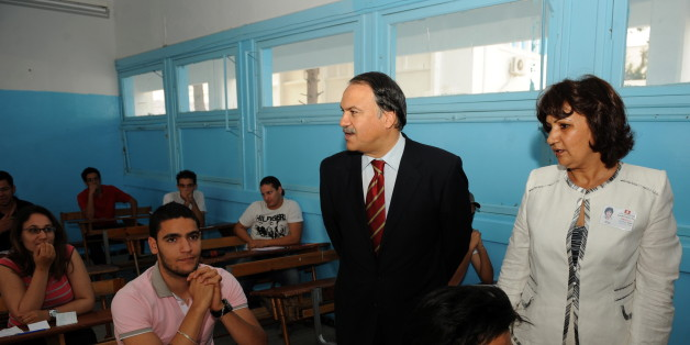 Tunisian Education Ministre Hatem Ben Salem (C) accompanied by the school's headmaster Jamila Sakka (R) meet Tunisian students taking the baccalaureat (high school graduation exam) exam on June 9, 2010 in Tunis.  AFP PHOTO / FETHI BELAID (Photo credit should read FETHI BELAID/AFP/Getty Images)