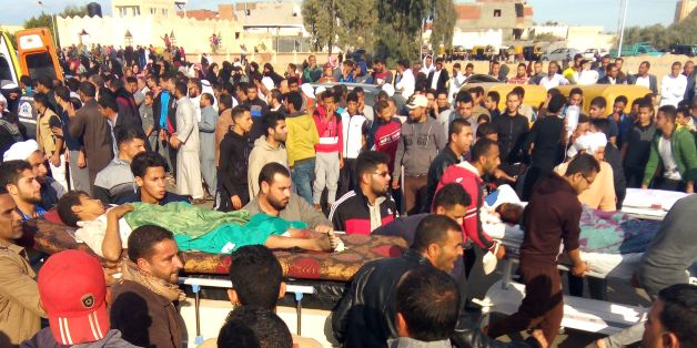 Egyptians carry victims on stretchers following a gun and bombing attack on the Rawda mosque near the North Sinai provincial capital of El-Arish on November 24, 2017.Armed attackers killed at least 235 worshippers in a bomb and gun assault on the packed mosque in Egypt's restive North Sinai province, in the country's deadliest attack in recent memory.   / AFP PHOTO / -        (Photo credit should read -/AFP/Getty Images)