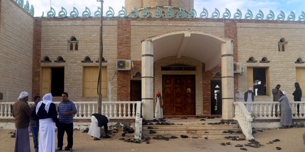 People stand outside Al Rawdah mosque, where a bomb exploded, in Bir Al-Abed, Egypt November 25, 2017. REUTERS/Mohamed Soliman