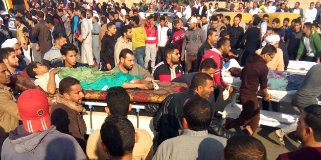 TOPSHOT - Egyptians carry victims on stretchers following a gun and bombing attack on the Rawda mosque near the North Sinai provincial capital of El-Arish on November 24, 2017.Armed attackers killed at least 235 worshippers in a bomb and gun assault on the packed mosque in Egypt's restive North Sinai province, in the country's deadliest attack in recent memory.   / AFP PHOTO / -        (Photo credit should read -/AFP/Getty Images)